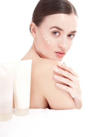 humidify: Young woman with  a well-groomed skin applying beauty product. Skincare consept.