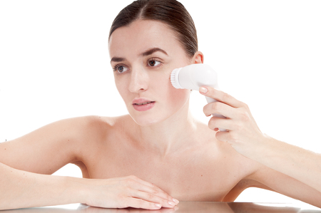 humidify: Woman with brush for deep cleansing facial. Skin care concept. High technology beauty.