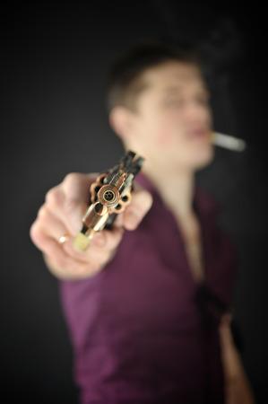dangerously: man aiming a gun