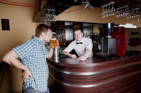Man tasting beer at the bar photo