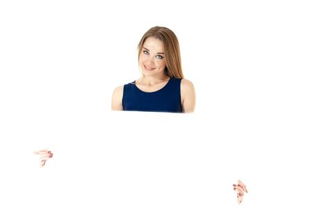 Beautiful woman showing empty placard, isolated on white background space for text. photo