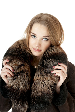 Elegant stylish woman in fur against white background photo