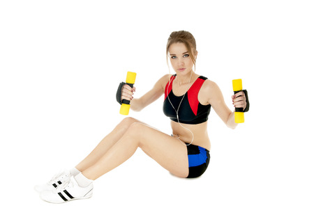 heartiness: Sports girl  exercising with dumbbells on white background. Healthy lifestyle concept.