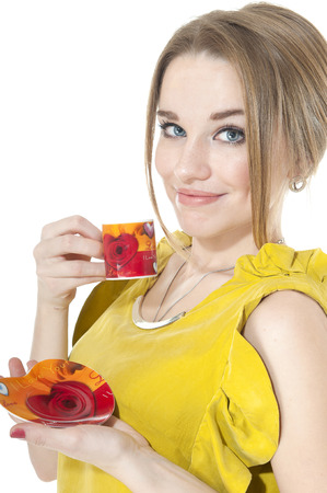 cosily: Dreamy woman with cup of coffee on a plate, isolated on white background.