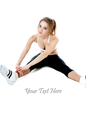 exertion: Athletic woman doing stretching exercises, isolated on white background.Healthy lifestyle concept.