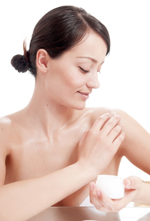 humidify: Beautiful woman applying cosmetic cream treatment on her body. Skin care concept.