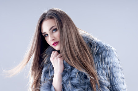 makeups: Winter fashion woman in a fur coat. Stock Photo