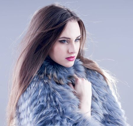Winter fashion woman in a fur coat. Stock Photo