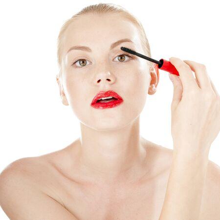 primp: Beautiful girl applying mascara on her long hair - isolated on white background.
