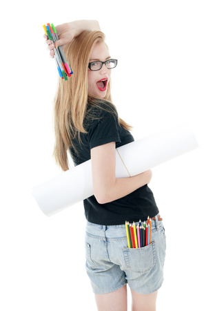 t off: Happy young girl with  colored pencils, felt-tip  and white roll paper, wearing black t-shirt, denim shorts, glasses.  Creativity concept. Stock Photo