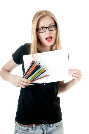 denim shorts: Happy young girl with  colored pencils  and empty white blank  paper, wearing black t-shirt, denim shorts, glasses.  Creativity concept.