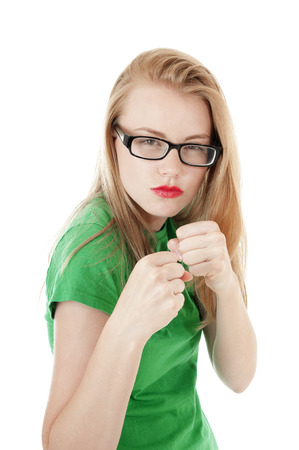 stubbornness: Pretty young girl is ready to take a hit.Isolated on white.