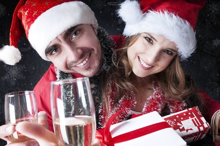 funny glasses: Funny Christmas couple with glasses of champagne  covering snowy background Stock Photo