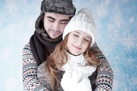 dearly: Happy young couple   covering  snow background