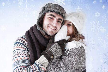 Girl whispering a secret boyfriends ear.Happy young couple gossiping.Snowy card.