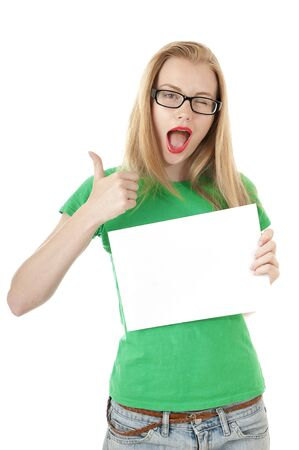 Pretty young girl showing empty blank paper sign for text and shows thumb up on white background. photo