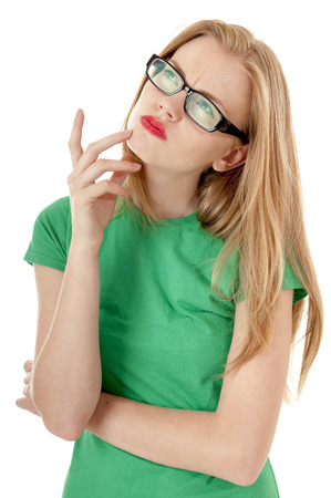 wondered: Pretty young girl in a green T-shirt wondered white background. Stock Photo
