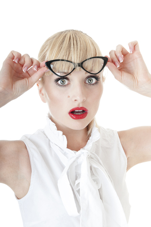 Shocked business woman in glasses over background. photo