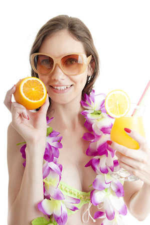 lei: Hawaii woman in bikini wearing flower lei garland of pink orchids and holds orange cocktail over white background.