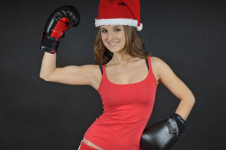 winning mood: christmas funny girl  wearing boxing gloves