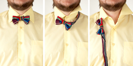 arbitrary: Set of colorful striped  bow tie with yellow shirt closeup.