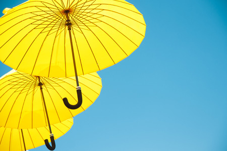 Yellow umbrellas under a sunny sky photo