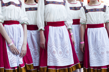 slavonic: Girls in Slavonic national costumes  preparing for a dance performance.