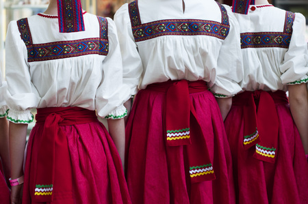 ukrainian ethnicity: Girls in Slavonic national costumes  preparing for a dance performance.
