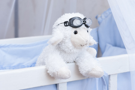 frill: Children room. Soft toy sheep in the nursery.