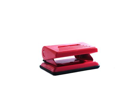 hole puncher: Red hole puncher for office papers. Stock Photo