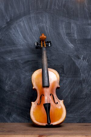 wooden surface: Violin on a slate background.