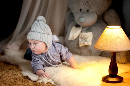animal angelic: Cute happy baby boy portrait lying on fur Stock Photo