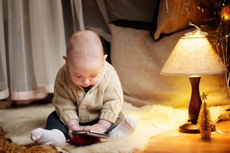 animal angelic: Cute happy baby boy  sitting on fur