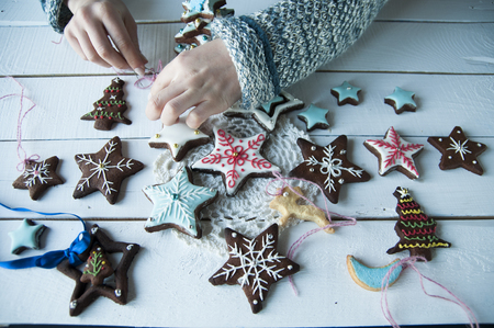 women's hands: womens hands and christmas cookies on a wooden background