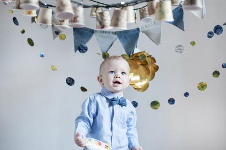 surprised baby: surprised baby boy celebrating his birthday Stock Photo