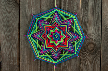 tantra: mandala of thread on wooden boards Stock Photo