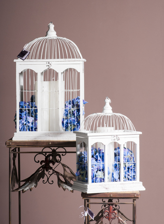paraffin: white wooden bird cages with blue hydrangeas and paraffin candle inside for decoration