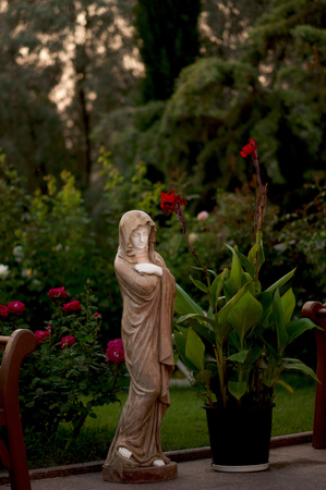 statue of Our Lady in the garden Stock Photo