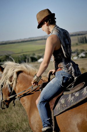 Stylish girl on horse in step