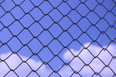 behind: Blue sky behind wire grating -Abstract background