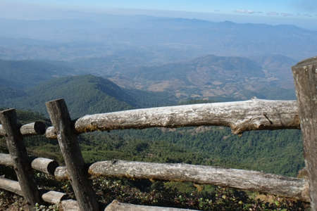 wooden railings: wooden railings on a mountain background Stock Photo