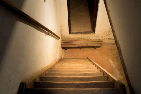 Scary spooky wooden stairs to the basement Stock Photo