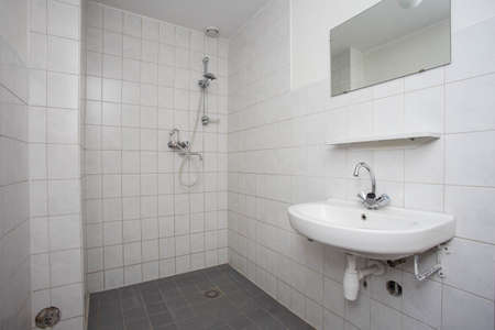 Simple Old Clean Bathroom With White Tiled Floor Sink And Shower