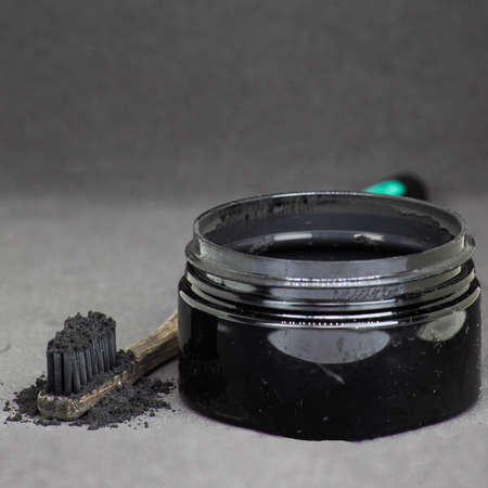 Charcoal on a toothbrush to whiten teeth Stock fotó