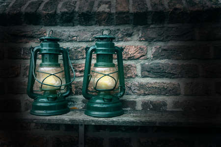 Old antique oil Lamp at Night on a Wooden Surface