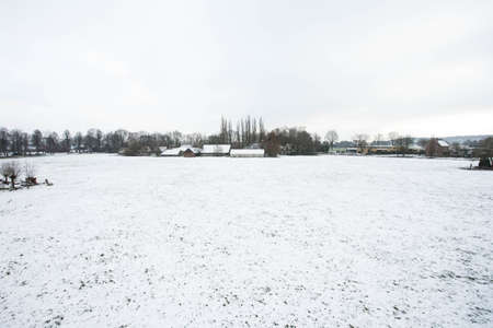 Snow landscape with farm field, meadow, white nature Stockfoto