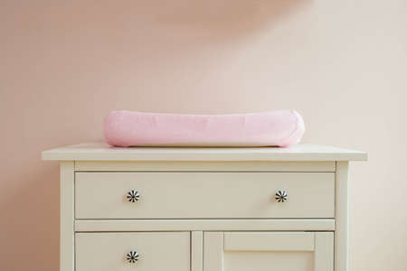 Changing mat in baby room modern design, pink colors cute