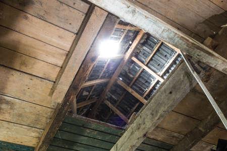 window light in dark old Abandoned Attic Imagens