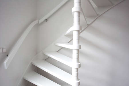Stairs in modern white room, white wooden stairs with white wall