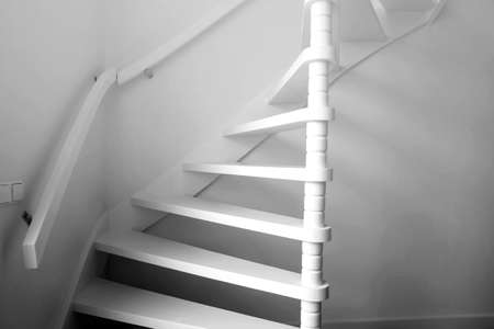 Heavy shadow of stairway Black and White, wooden stairs modern design Stock Photo
